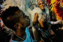 Participants preparing outside and parading in the Samba School Carnival Parade at the Sambodromo.