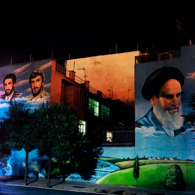 A mural of Khomeini and brother martyrs from the 8-year long Iran-Iraq war in southern Tehran neighborhood.
