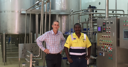 Laga Industries General Manager Gerard O'Brien and Engineering Manager Jeremiah Jerewai review new machinery as part of Gala's new ice cream facilities. Credit: Laga Industries.