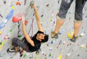 Mike Moelter climbs in Movemen'ts gym facility in Boulder.