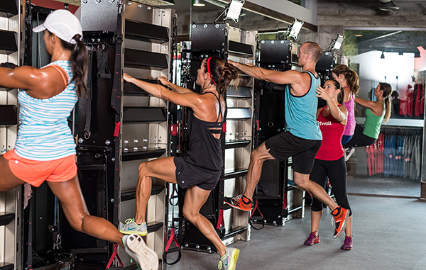 The Fitwall fitness concept dedicates part of the class to a wall-mounted ladder workout. Photos courtesy of Fitwall.