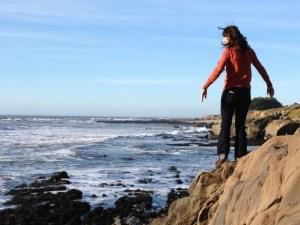 girl-rocks-ocean-coast
