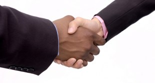 A professional handshake is firm and unassuming. It's often accompanies by eye to eye contact.