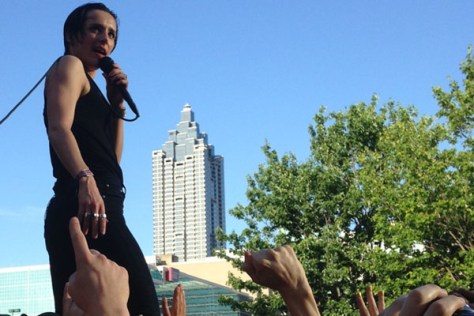 Savages lead singer Jehnny Beth singing while crowd surfing at Shaky Knees 2016, in probably the best picture I'll ever take at a concert.