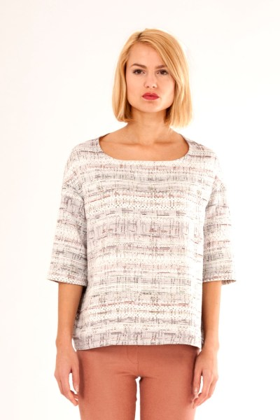 Loose fit top with low shoulders, 3/4 sleeves and detail in back. By Barbara van der Zanden