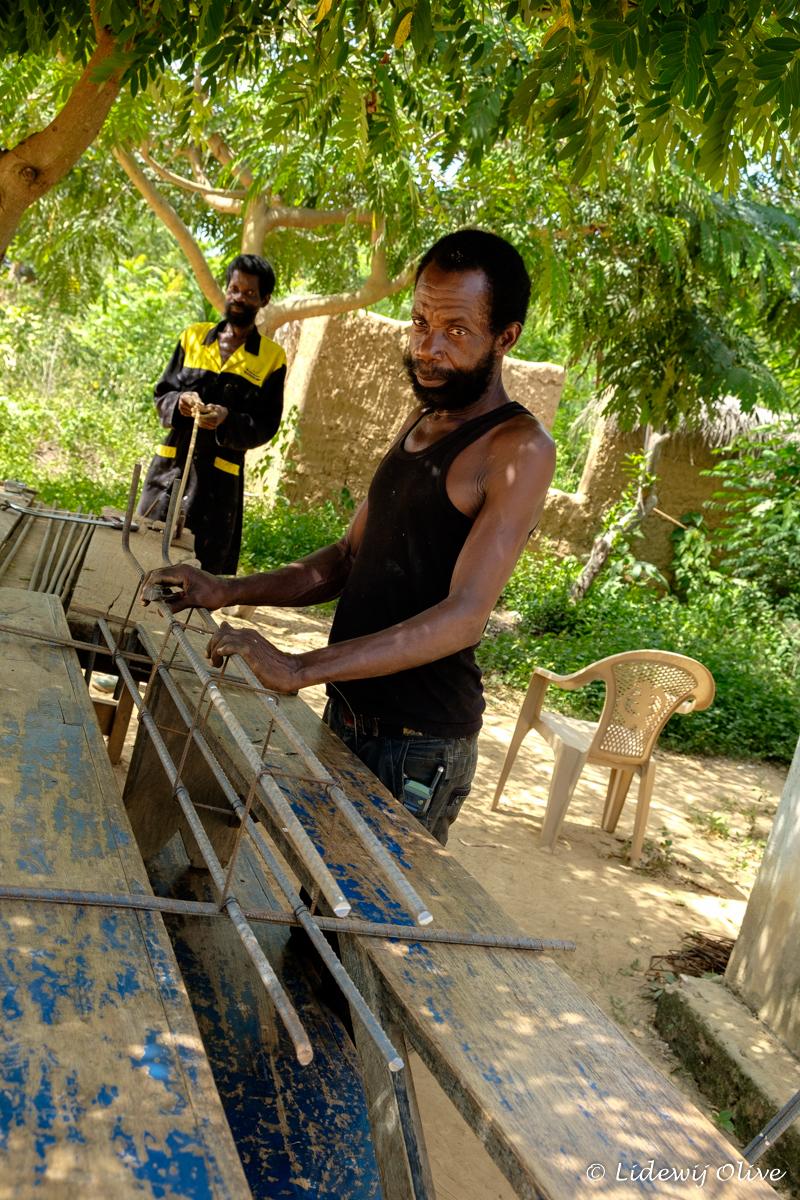 strong men building a house in Atsiekpoe, Ghana
