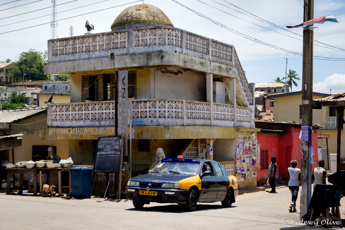 taxi driving in the streets of elmina, Ghana