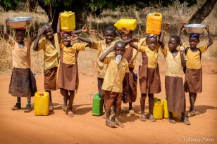 Children carrying water