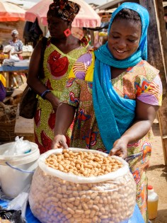 Selling kule kule (something like peanut chips) at the market