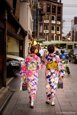 Women dressed up as Geisha at nightfall