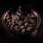 Close-up coffee grinder and beans. Macro.