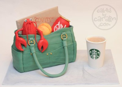 Purse cake with lobster, Coca-Cola, Starbucks, a peach and a confidential folder.