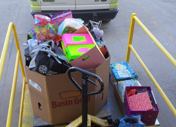 Tears of joy and happiness fill our faces from the 560 lbs of birthday bags donated by H!P Kids!