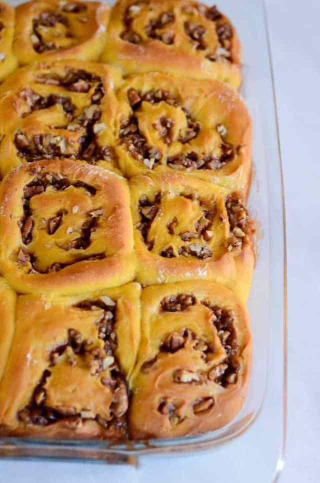 Pumpkin Praline Cinnamon Rolls with Bourbon Cream Cheese Frosting | CaliGirlCooking.com