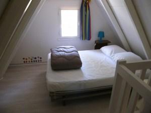 Chambre parentale avec meuble de rangement