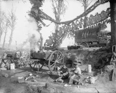 Cooks of the King's Own Yorkshire Light Infantry prepare a meal for their battalion on field cookers near Ypres.