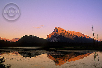 Mount Rundle and First Vermilion Lake at sunset