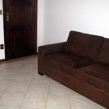 Sala com sofá cama