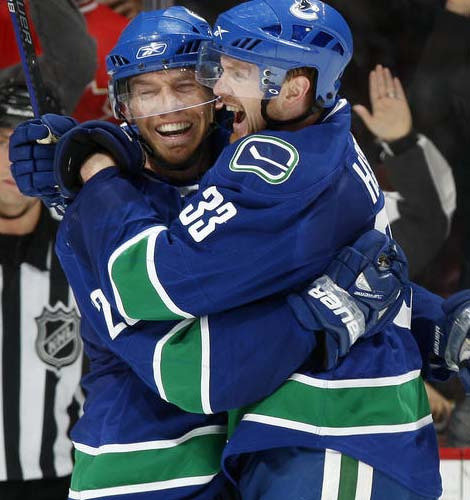 Henrik Sedin and Mikael Samuelsson celebrate another goal.