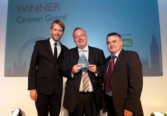 Chris Nettleton accepts awards on behalf of Caravan Guard