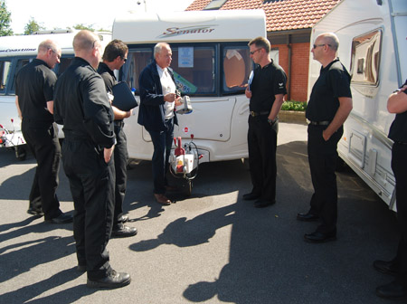 Caravan security consultant Tim Booth briefs the team