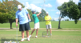 Trey Whitnell, junior, Jay Taylor, freshman, and Hunter Travis, sophomore, prepare for the 2014 golf season Sept. 3, 2014.   Photo by Meg Rushing