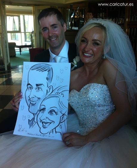 Newly married couple being entertained by Irish caricature artist Allan Cavanagh!