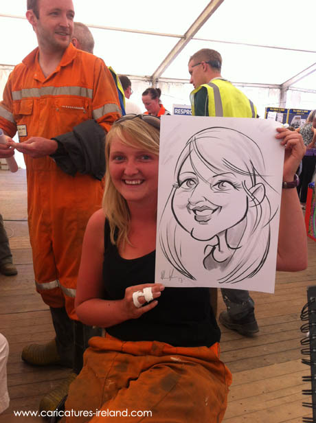 Miner laughing at her caricature by Allan Cavanagh
