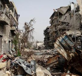 This citizen journalism image provided by Aleppo Media Center AMC which has been authenticated based on its contents and other AP reporting, shows damaged buildings due to heavy fighting between government forces and Free Syrian Army fighters in Aleppo, Syria, Thursday, Sept. 19, 2013. A Syrian activist group says al-Qaida-linked gunmen have captured a town near the Turkish border after heavy fighting with a rebel group. (AP Photo/Aleppo Media Center, AMC)