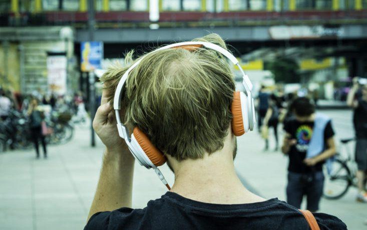 Man with headphones in Berlin-Mitte