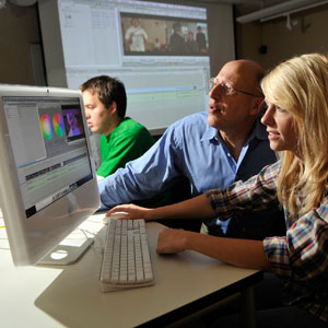 """Film and TV Production (not sure exact name for caption; refer to story) was """"saved"""" from proposed cuts at Western Carolina University. This is a WCU stock photo of that program, with (for caption)  Jack Sholder, professor and director of the Motion Picture & Television Production program (proper and complete name), helping a student in editing class. Photo courtesy of Western Carolina University."""