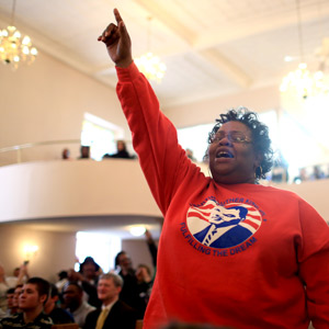 "Karen Cowan cheers and sings along to ""My God is Awesome,"" which was led by Dr. Lamar Hylton during Monday's service at St. James AME Church in Asheville. The service was the start of the Annual Peace March and Rally held by the Martin Luther King Association of Asheville and Buncombe County. The association organized many events during the weekend in celebration of the Rev. Martin Luther King Jr. and his legacy. Colby Rabon/Carolina Public Press"