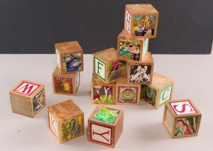 "Agrarian Alphabet Blocks, mixed media/claybord inset into wood 2.5""x2.5""x2.5"""