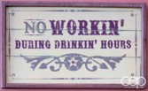 """A sign at Grover's reading: """"No Workin' During Drinkin' Hours"""""""