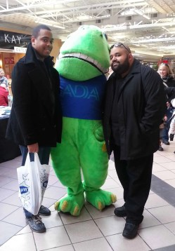 Justin and Marcel posing with a mascot for a dental awareness group in Buffalo, NY