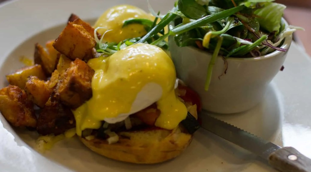 Eggs Benedict with Roasted Vegetables and Aged White Cheddar at Lady Marmalade in Toronto, ON