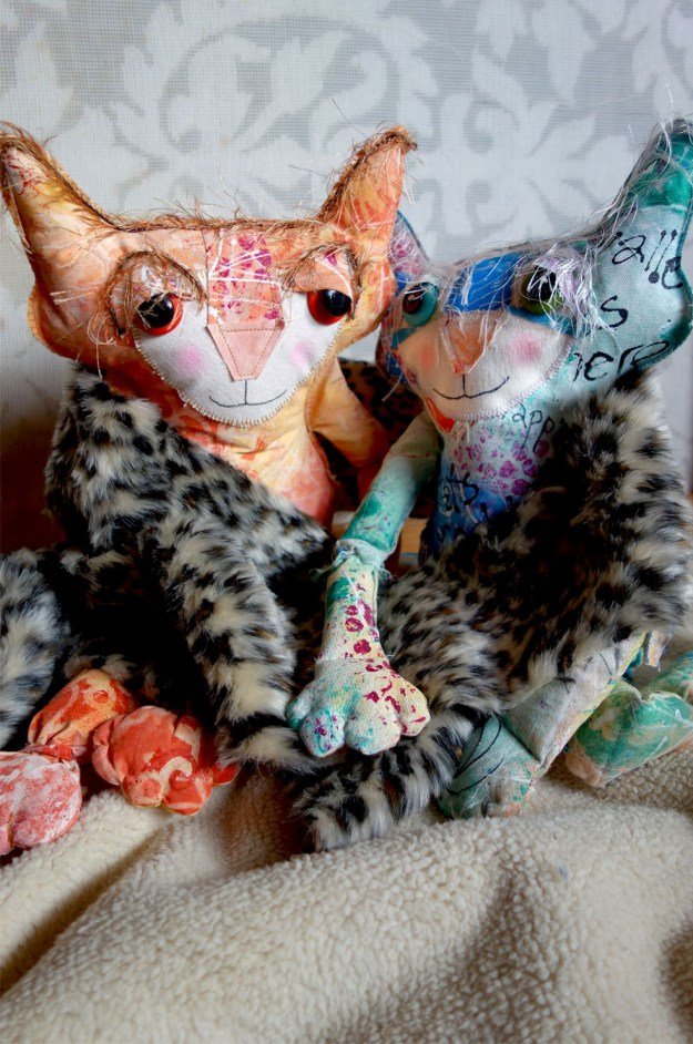 Ginger and The Chairman wrap the fluffy animal skin print around their shoulders. The Chairman stares at her longingly.
