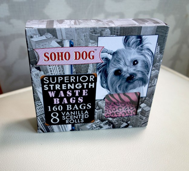 A pretty box filled with rolls of Doggie poop bags.