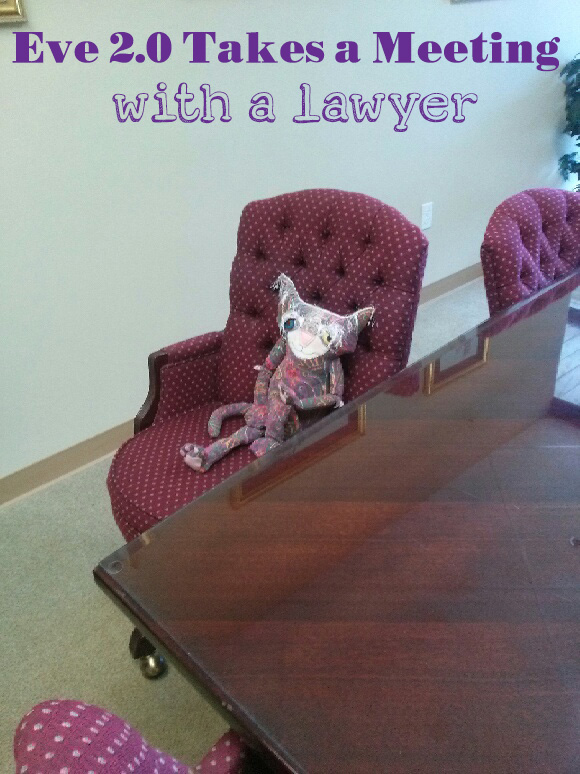 Eve 2.0, the cute cat doll sits at the conference room table in a trademark lawyers office.