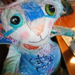 The Chairman of Catberry Tails. A very colorful soft sculpture cat made from hand painted fabric. One of the first dolls made!