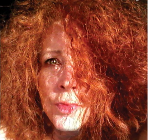 Kreatrix with very wild, out of control red hair. Can't really see her face. Too much hair!