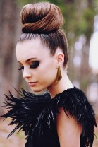 Sleek top knot with big lashes3