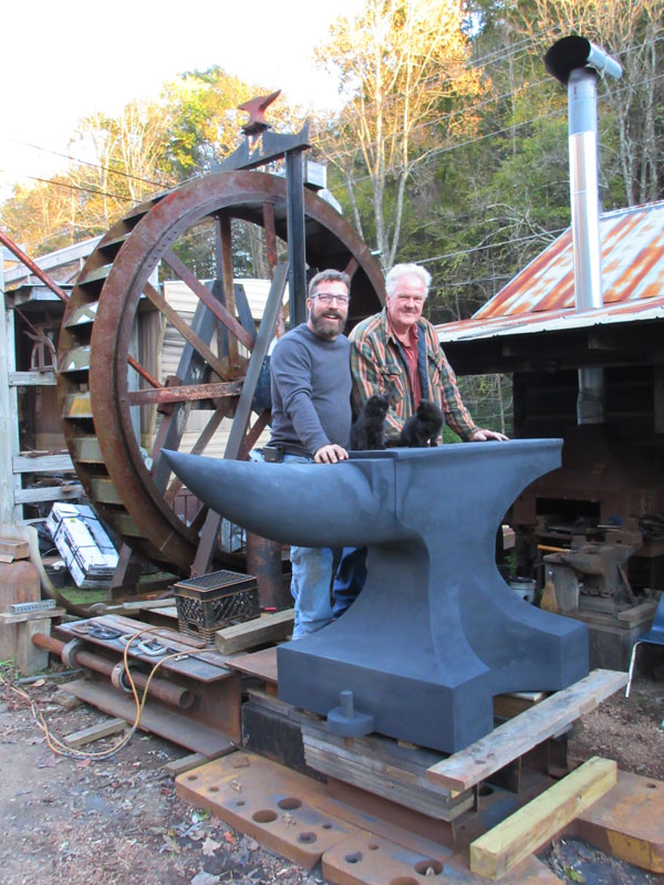 J.D. Napier and Jordan with the world's biggest anvil?