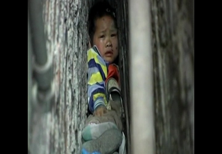 Boy Trapped Between Walls