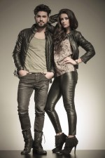 in love couple dressed in leather clothes in a fashion pose in s