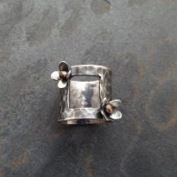 Sterling Silver ring with 2 blossoms with copper accents and square cut out 15 mm wide