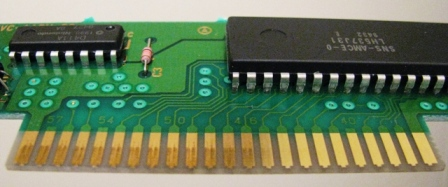 A typical Super Nintendo game PCB. The contacts on the left are dirty from years of use. The contacts on the right have been cleaned with nothing more than an eraser, and look like new.
