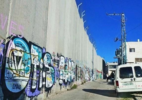 Israel defense wall street view white van