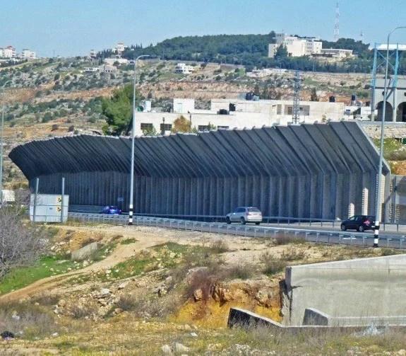 Israeli defense wall along road