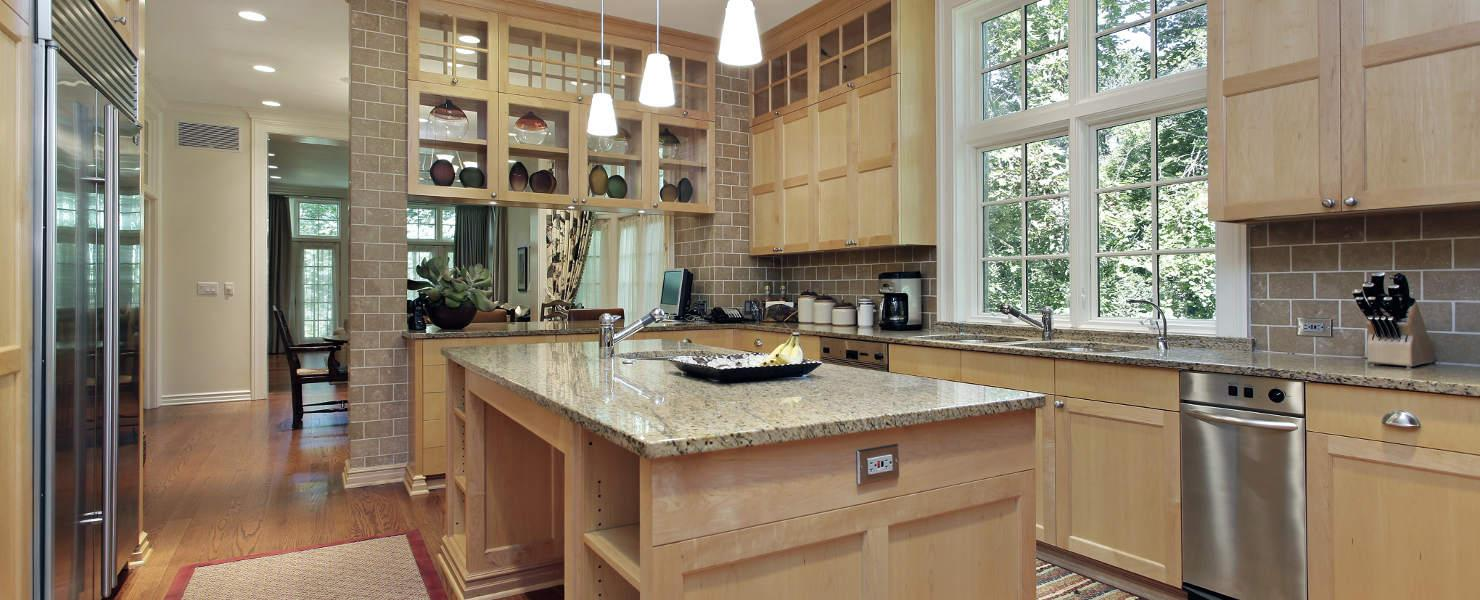 Kitchen with oak wood cabinetry and granite counter